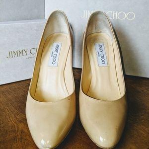 Jimmy Choo nude pumps.